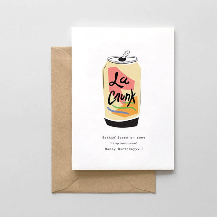 A Birthday card printed on thick white card stock with an image of a can of La Croix grapefruit sparkling water and the words 'Gettin' loose on some pamplemousse! Happy Birthday!! below.
