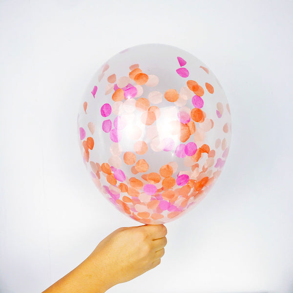 Confetti Balloons - a clear high quality latex biodegradable balloon filled with orange sherbert confetti that is so much fun.