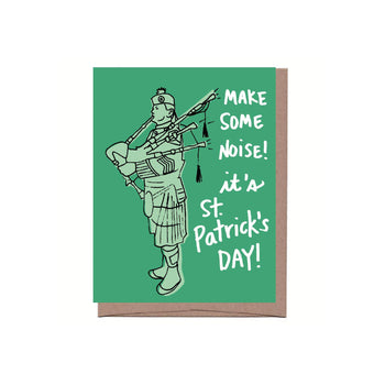 A St. Patrick's Day Greeting Card featuring a bagpipe player on a green card with the words 'make some noise! it's St. Patrick's Day!'