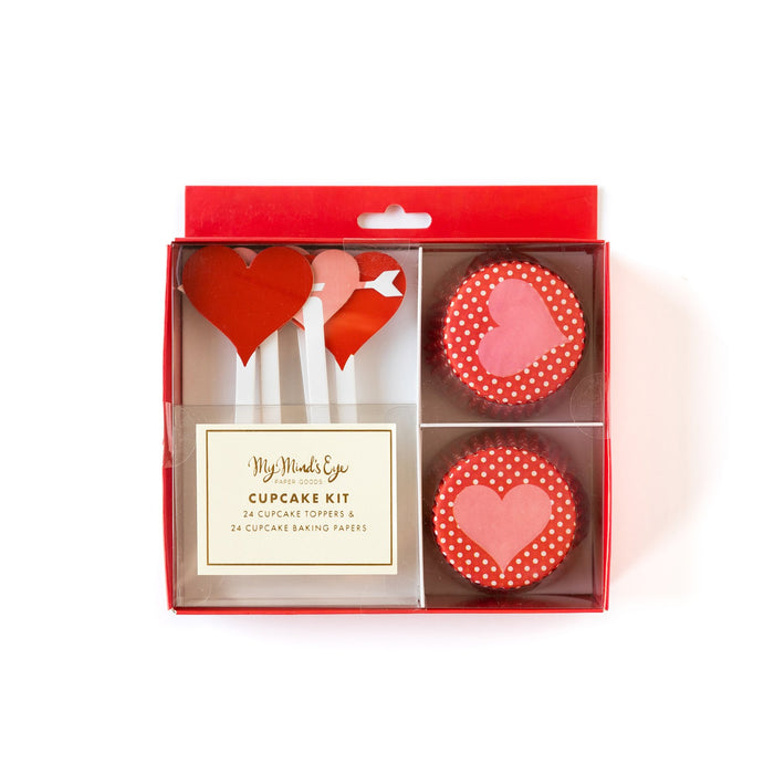 A Valentine's Day themed cupcake kit containing baking cups and heart decorations