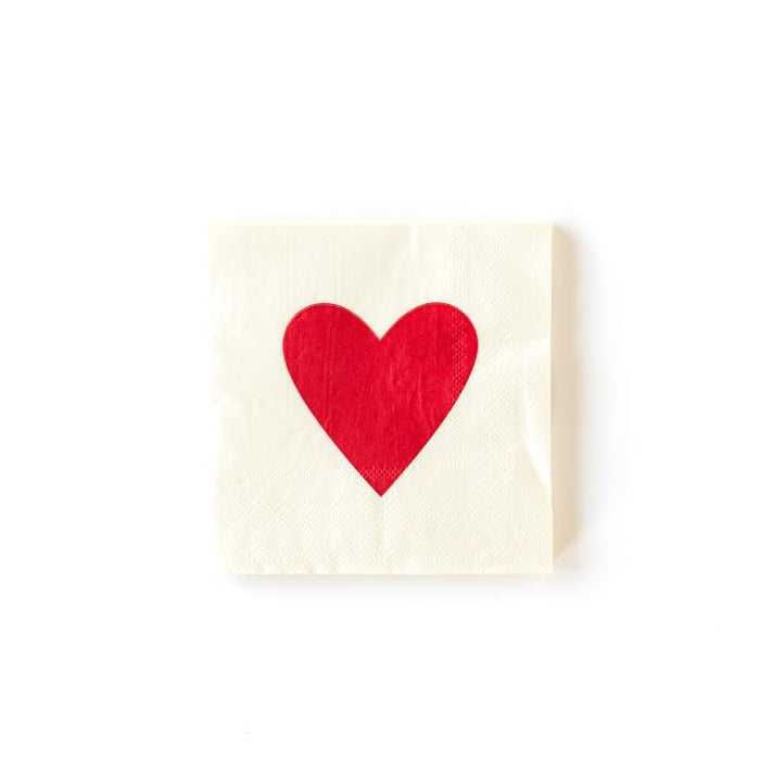 A white Valentine's day themed napkin with a large red heart in the center