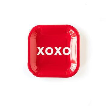 A Red Valentine's day themed party plate with XOXO written in white text