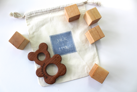 Organic cotton drawstring bag for easy storing of our jack and link all natural and organic wooden toys.