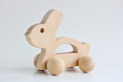 Handmade wooden push toy for babies and toddlers.