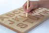 Wooden alphabet tracing board.