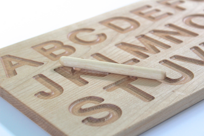 Wooden alphabet tracing board for preschool kids and kindergarten.