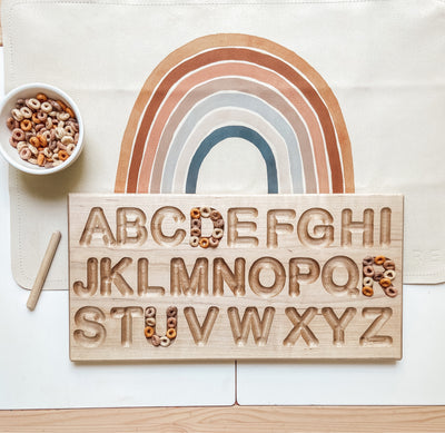 Alphabet wooden tracing board made out of maple with pen included.