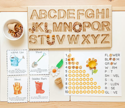 Montessori learning materials using an alphabet tracing board with wooden stylus pen for Montessori activities.