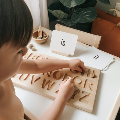 Preschool learning wooden alphabet tracing board.
