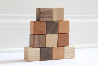 All natural and non toxic Wooden toy stacking blocks of different colors and textures.
