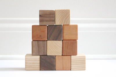 Organic wooden toy stacking baby blocks for hand and eye coordination.
