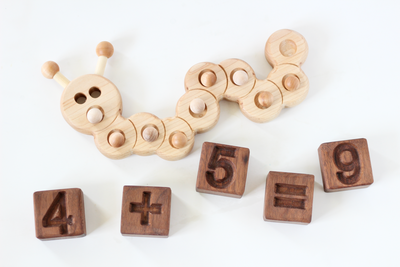 Wooden caterpillar ten frame for preschool and kindergarten math with fun wooden number blocks.