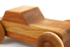 Toy car for kids in cherry hardwood and handmade in the United States.