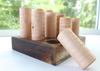 Organic wooden shape sorter for babies and toddlers made out of walnut and maple.