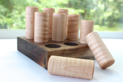 Wooden shape sorter made with large chunky sizes for baby hand and eye coordination.