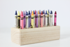 Wooden crayon holder.