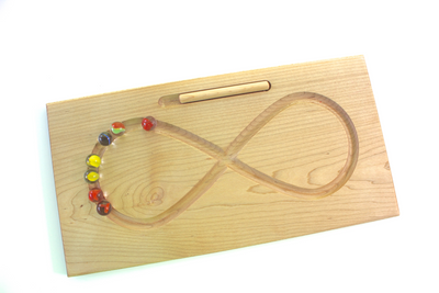 Wooden figure 8 tracing board with marbles and stylus.