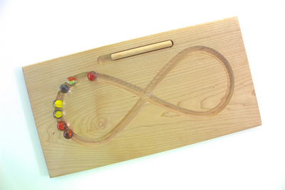 Lazy 8 figure 8 tracing board educational learning toy for using both hemispheres of the brain used by occupational therapists.