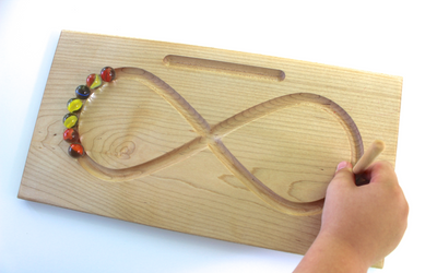 Early development learning toys for toddlers and children using the figure 8 lazy 8 tracing board.