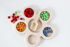 Loose parts tinker tray with wool balls.
