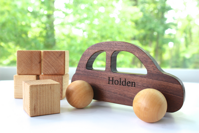 Organic wooden push car personalized with the name Holden.