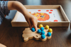 Wooden lion ten frame for early learning math aids.