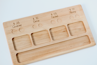 Kids wooden money sorting activity board.
