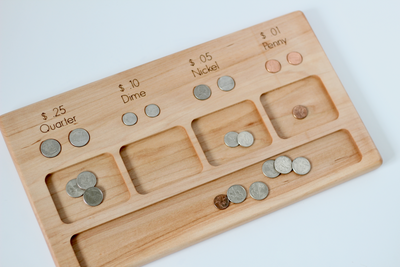 Wooden money activity board for change sorting.