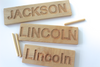 Personalized wooden name tracing boards for preschoolers Jackson and Lincoln.