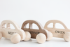 Baby push along wooden cars all natural and organic and personalized with the names Wells, Connor, and Owen.