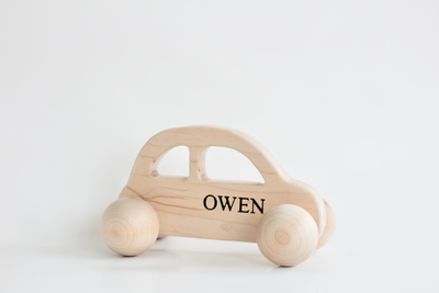Baby push toy car personalized with the name Owen.
