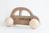 Baby push along car in all natural and organic walnut personalized with the name Connor.