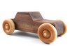 Children's wooden toy push car made out of walnut hardwood.
