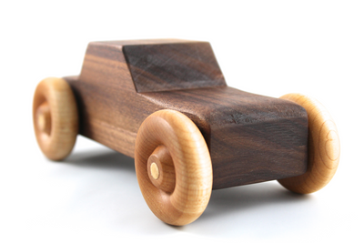 Children's all natural wooden toy car in walnut.