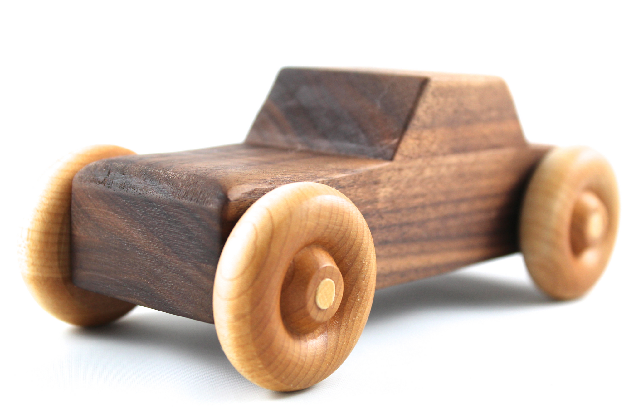 Handmade wooden toy car made out of a beautiful brown walnut.