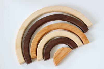 Wooden stacking rainbow created using three different types of organic hardwoods.
