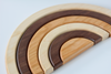 Organic wooden rainbow stacking toy in three different all natural shades of wood for stacking.