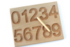Preschool learning toy and wooden number tracing 1-10 board.