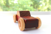 All natural wooden toy cars in all natural colors.