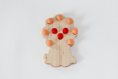 Lion ten frame for preschoolers with wooden painted balls.