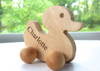 All natural and organic wooden push toy duck with personalized name.