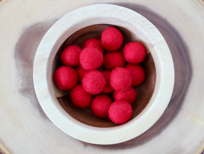 Chunky red felt balls for messy play and to use as math counters.