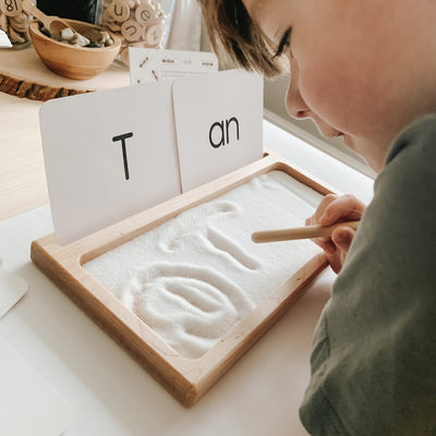 Montessori homeschool wooden tracing tray with note card stand.