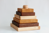 Square wooden stacking toy made from three types of hardwoods.