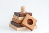 Square wooden stacking toy in three different colored hardwood.