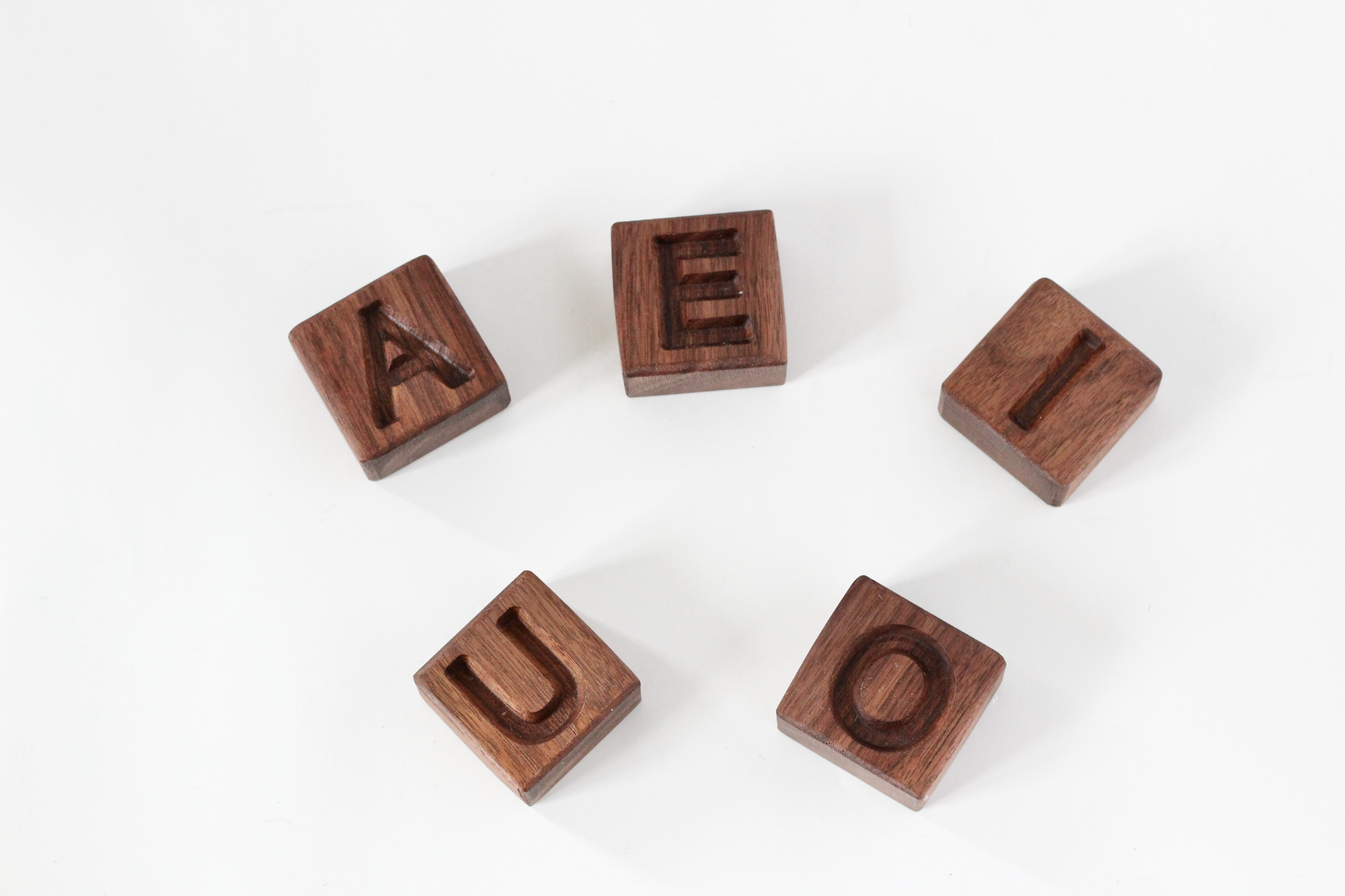 Wooden alphabet vowels or word building.