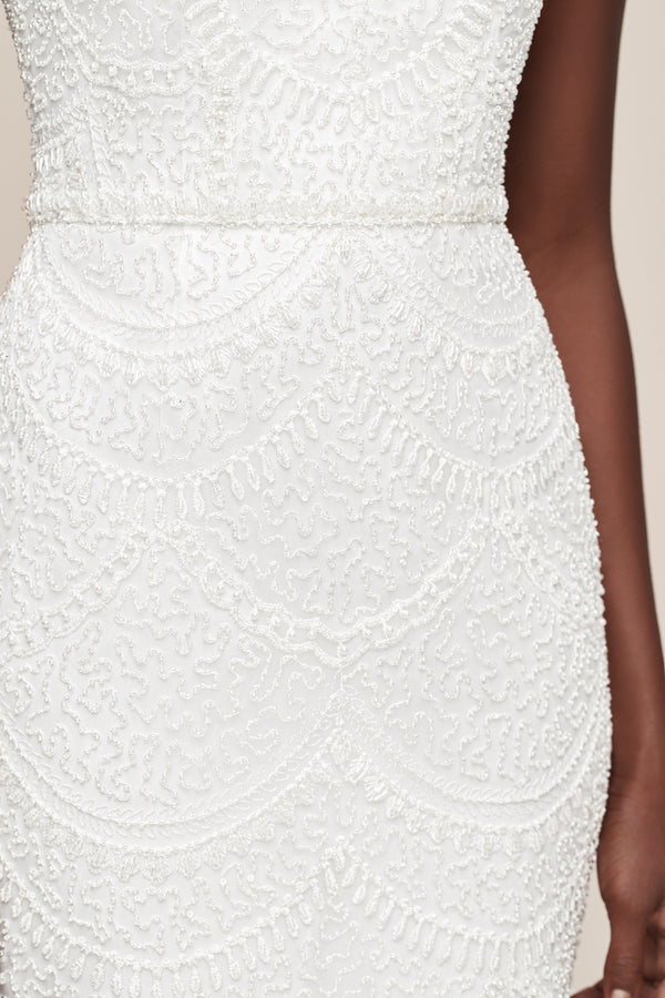 Beaded white dress with embroidered lace perfect for bridal shower