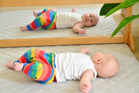 how we montessori baby in front of mirror