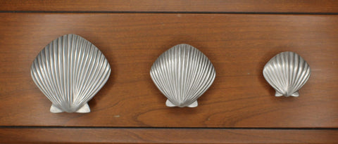 Our small, medium, and large scallop seashell cabinet knobs