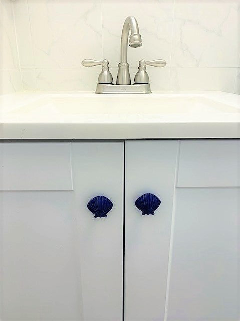 Blue scallop knobs on vanity